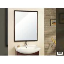 Small beveled framed bathroom mirror