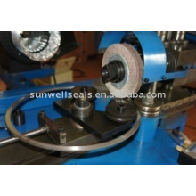 Spiral wound ring polish machine