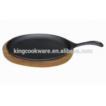 sartén de hierro fundido bandeja de madera