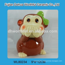 Painting ceramic piggy bank w/ monkey statue