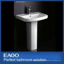 ceramic pedestal wash basin in bathroom
