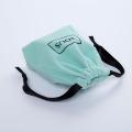 mint green mini velvet pouch with black string