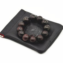 Single pull portable leather gift pouch