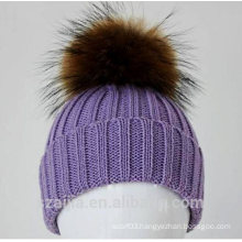 Ladies fashion knitted beanie with fake fur pom