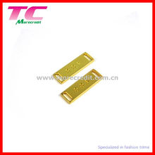 Glänzende Gold Metallplatte für Bademode