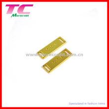 Placa de metal brillante de oro para el traje de baño