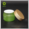 Hot sale high quality 50g green empty cosmetic glass cylinder jar with aluminum cap