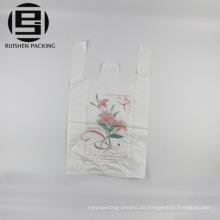 Biologisch abbaubares T-Shirt aus Kunststoff mit Tragetaschen