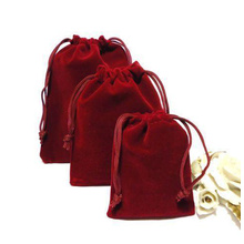 Red velvet jewelry pouch with red string