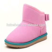 Botas coloridas da neve do inverno das botas dos miúdos para trás bowtie