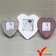 Mehrfarbiges hölzernes Vintages dreifaches Liebes-Herz-Form-reizender Foto-Rahmen