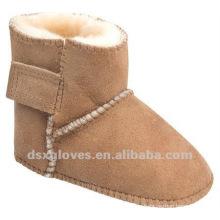 Zapatos de invierno de piel de oveja para el bebé