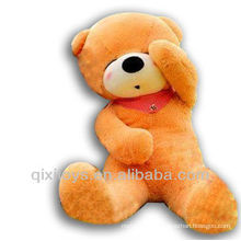light brown stuffed doze bear scarf teddy bear