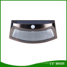 Sensor de infrarrojos de iluminación LED 8 LED de energía solar Lámpara de pared de sonrisa Lámpara de jardín al aire libre marrón y negro