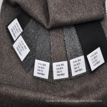 Tejido de lana en espiga de lana gris