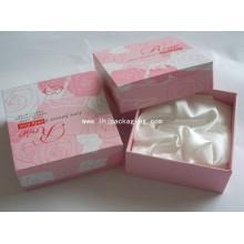 Caja de papel de embalaje de cosmética de cartón elegante con satén