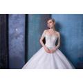Vestido de novia de novia con hombros descubiertos