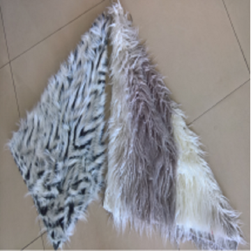 Jacquard weave and roller beam faux fur