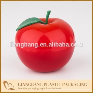 Manzanas rojas con plástico, tarro de doble pared con embalaje de cosméticos