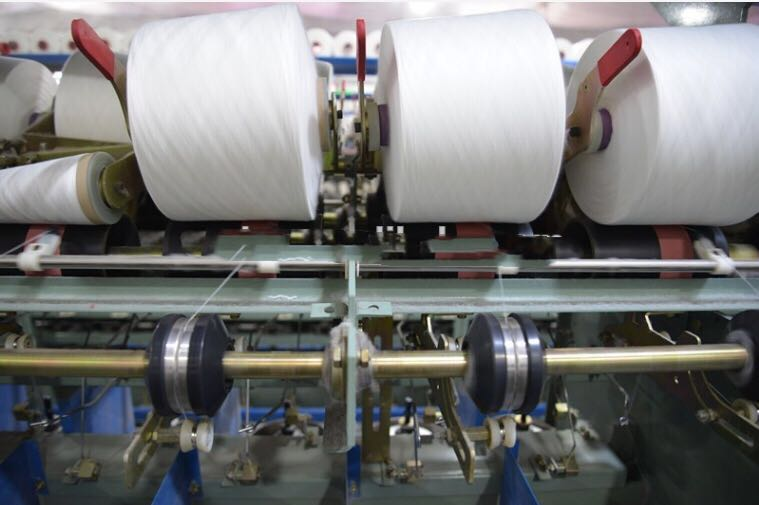 two for one twisting machine for short fiber