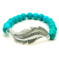 Turquoise 8MM Round Beads Stretch Gemstone Bracelet with Diamante feather alloy Piece