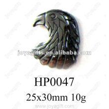 Pendentifs en tête d'aigle d'hématite