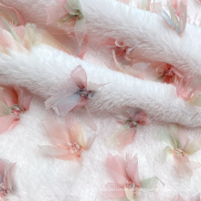 Soft hand feel pink polyester knitting synthetic faux fur fabric with embroidered bowknot