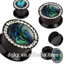 Negro doble abarrotado oído medidor de oído alrededor de los tapones de gemas