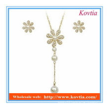 fancy jewelry set 2014 fashion snowflake design long pendant pearl necklace and earrings set