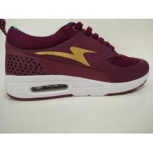Las mujeres ganan zapatos de running de la suela del aire rojo