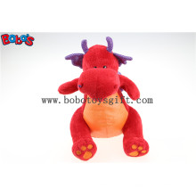 Hot Sale pelúcia suave brinquedo de dinossauro vermelho com asas brilhantes roxo Bos1201