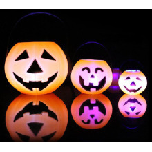 Halloween decorated pumpkin barrels