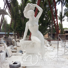 Woman pouring water statue marble fountain