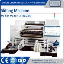 Plastic film slitting and rewind machine