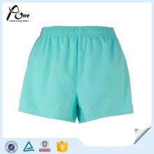 Pantalones cortos de gimnasio de poliéster de las muchachas desgaste al por mayor del gimnasio