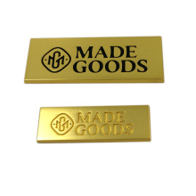 Étiquette personnalisée de logo en métal collé de matériel de vêtement