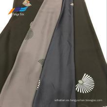 100% poliéster Nida impresa formal de tela negra para prendas de vestir