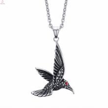 Pendentifs en acier inoxydable de crâne d'oiseau de bijoux de ruban d'aileron fait sur commande