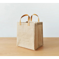 Tote bag in juta naturale impermeabile con cinturini in pelle
