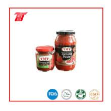 Pasta de tomate orgánica en lata, en envase nuevo Pasta de tomate en frasco de vidrio