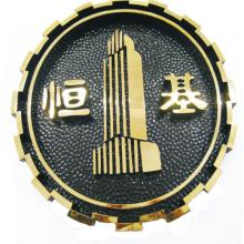 Insignia de la compañía plateada muestra grabada oro