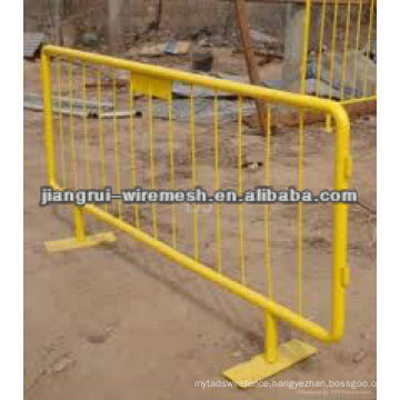 yellow crowd control barrier