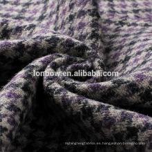 Tela de chaqueta de tweed de lana negra y gris morada