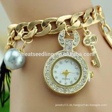 2015 Ausgezeichnete Dame geflochtene Perlenschlüssel-hängende Goldkettendiamant-Großhandelsporzellanuhr