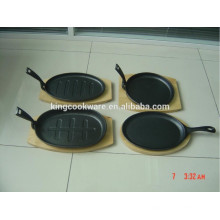 cast iron hot plate sizzling plate with wooden base
