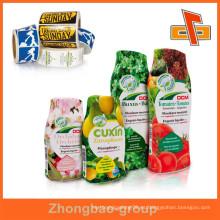 Material de embalaje hecho en China al por mayor OEM fábrica personalizar plástico pvc encogimiento etiqueta para botellas de bebidas con la impresión