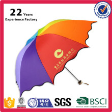 Fördernder Regenbogen-bunter kleiner faltender Regenschirm mit Logo-Drucken