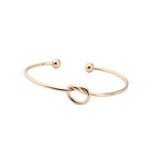 Free Sample IP Plated Gold Tie The Knot Lucky Stainless Steel Cuff Heart Knot Bracelet Bangle