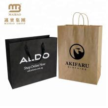 La fabrication en gros d'Oem a adapté aux besoins du client le sac différent d'emballage de papier de vêtements de luxe de style différent avec des poignées pour le shopping