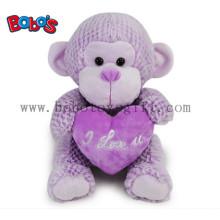 Fábrica de China Made Super lindo juguetes de peluche de mono púrpura con almohada de corazón púrpura